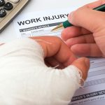 Reducing Workers' Compensation Costs in Construction injured person filling out a form